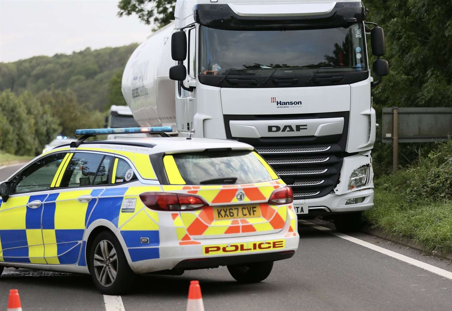 Teenager seriously injured after crash between lorry and bike on A43