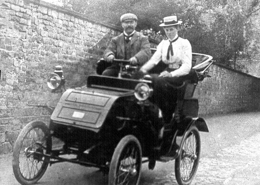 Dr Gilpin and passenger in his car in Church Walk, Bourne. Photo: Rex Needle. EMN-150818-115449001