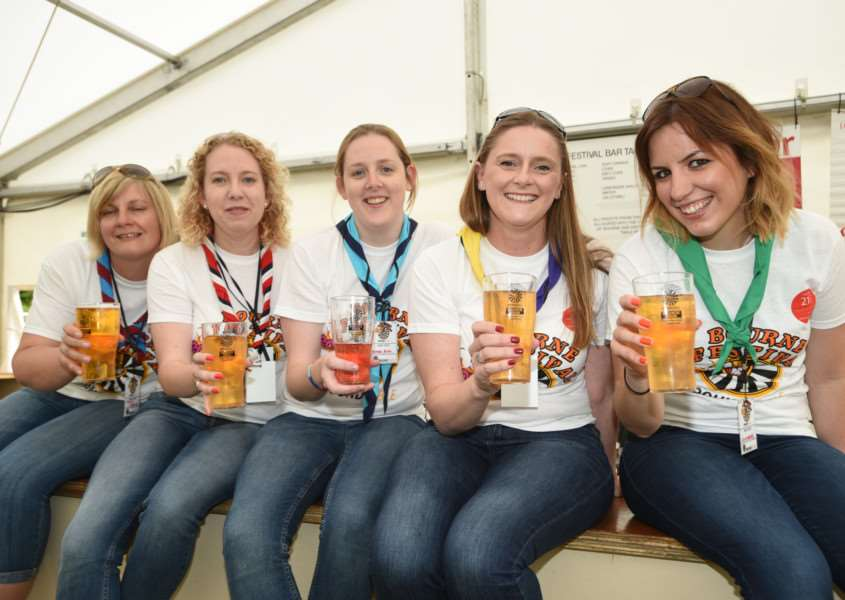 Bourne Festival 2015. Beer festival volunteers Caroline Osbourne, Cathy Herron, Michelle Herron, Louise Kidder and Laura Kelly from Bourne and district guides EMN-150606-003010009